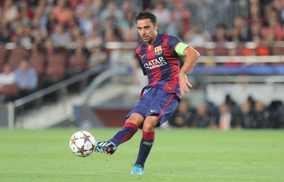Foto: Xavi dando un pase, la instantánea más fácil de conseguir del jugador catalán.