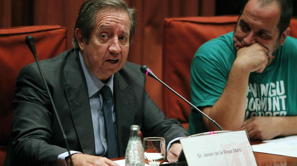 Foto:  El presidente de la comisión del Parlament sobre el fraude, David Fernàndez (d), escucha al financiero Javier de la Rosa (i). (EFE)
