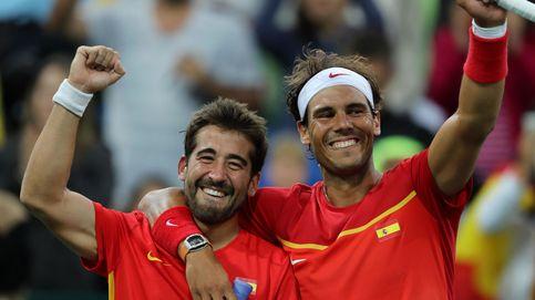 Dellavedova y yo viendo a Nadal y López ganar una medalla a través de una valla