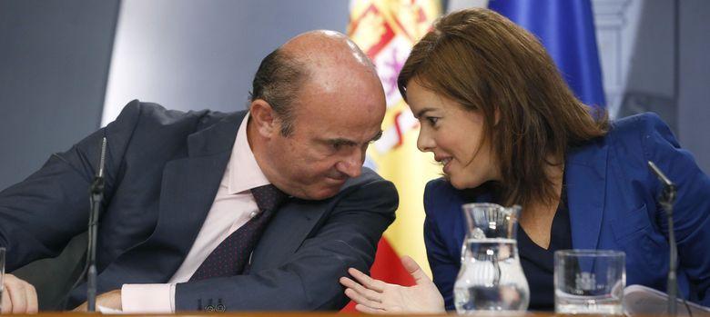 Foto: Soraya Sáenz de Santamaría y Luis de Guindos (EFE)