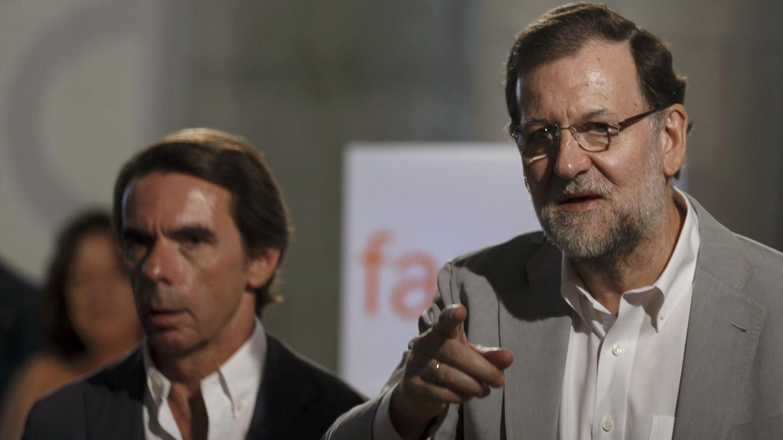 Mariano Rajoy y Jose María Aznar. (Reuters)
