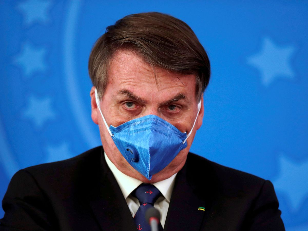 Foto: Jair Bolsonaro, protegido con una mascarilla ante el coronavirus (Reuters/Ueslei Marcelino)