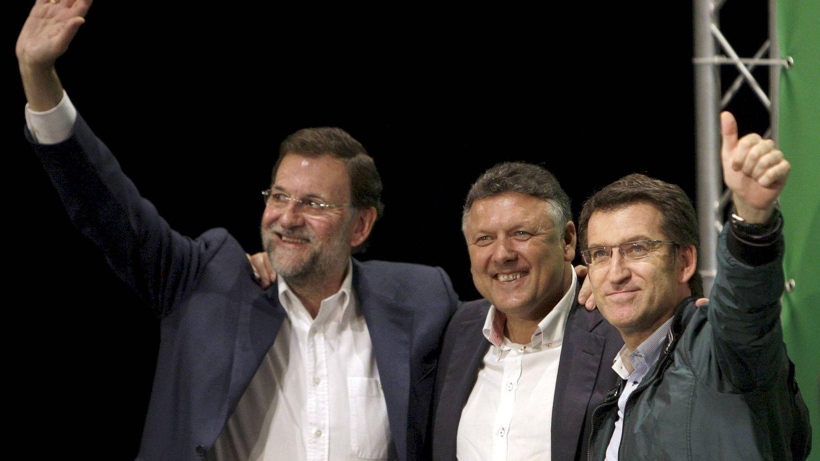 Foto: Telmo Martín (c), junto al presidente del PP, Mariano Rajoy (i), y el presidente de la Xunta, Alberto Núnez Feijóo. (EFE)