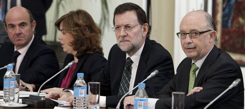 Foto: Luis de Guindos, Soraya Sáenz de Santamaría, Mariano Rajoy y Cristóbal Montoro. (Efe)