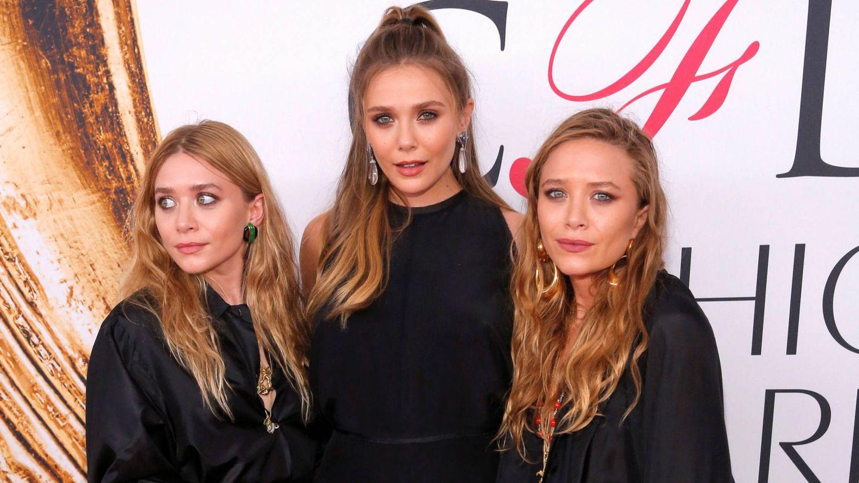 Elizabeth Olsen, Mary-Kate Olsen y Ashley Olsen. (Reuters)
