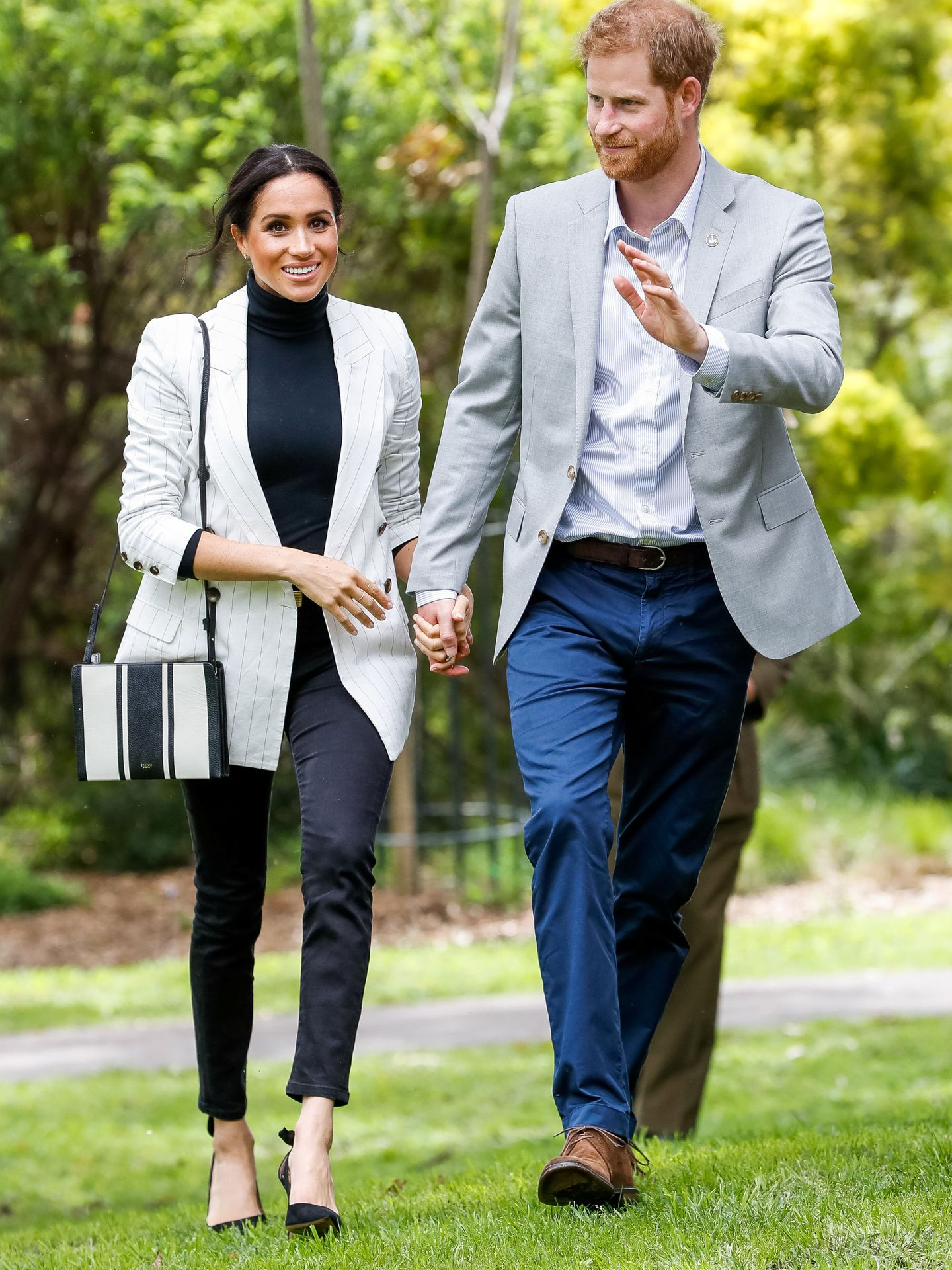 Harry y Meghan llegando a la recepción. (Reuters)