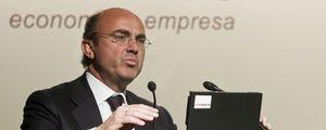 Luis de Guindos y Emilio Ontiveros abogan por aplazar la salida a bolsa de Bankia