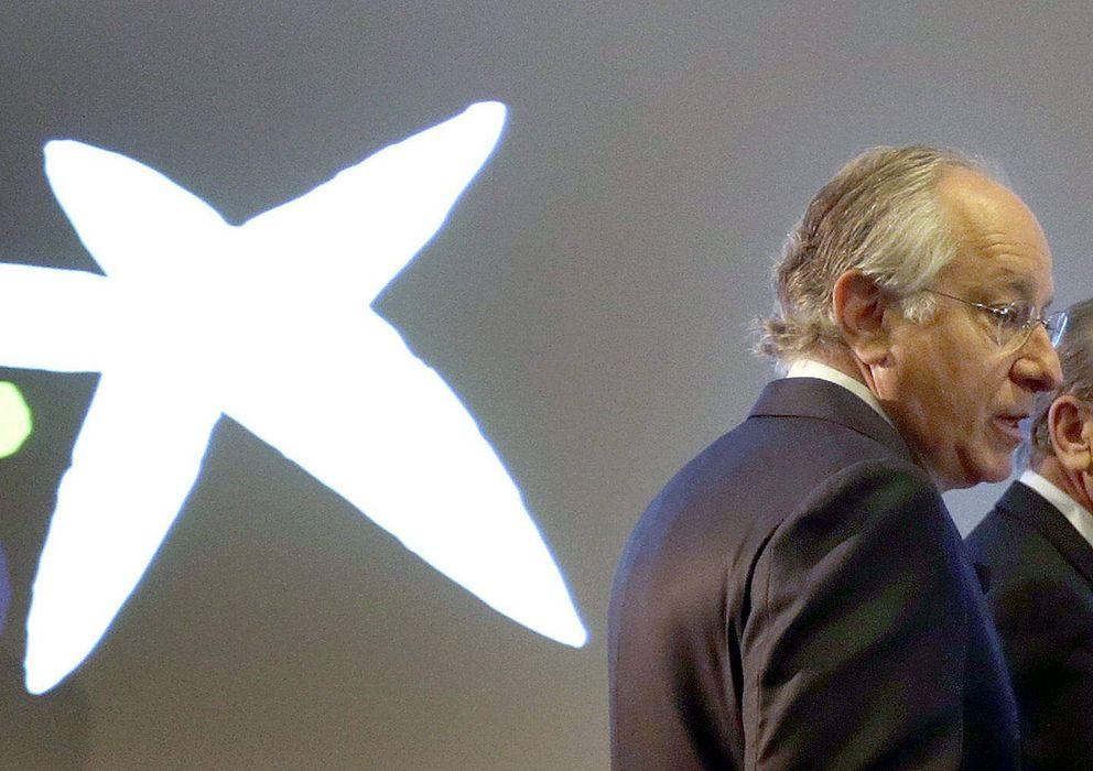 Foto: l presidente y el consejero delegado de CaixaBank, Isidre Fainé (d), y Juan María de Nin (Efe)