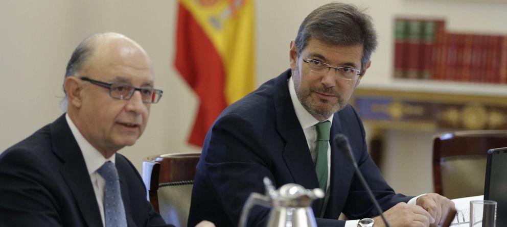 Foto: El nuevo ministro de Justicia, Rafael Catalá Polo (d), y Cristóbal Montoro (EFE)