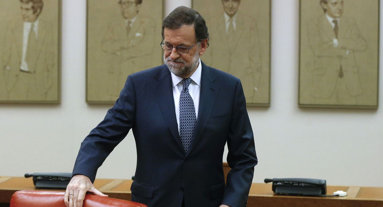 El jefe del Gobierno en funciones, Mariano Rajoy, a su llegada a la reunión que ha mantenido hoy en el Congreso con los diputados del PP. (EFE)