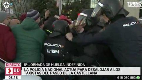 La Policía carga para desalojar a los taxistas concentrados en la Castellana