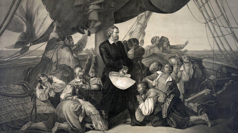 Ilustración de Cristóbal Colón de pie entre su tripulación a bordo del Santa María (Fuente: iStock)