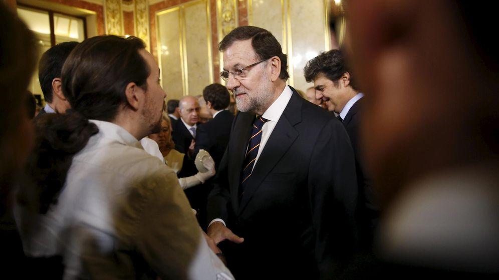 Foto: Pablo Iglesias y Mariano Rajoy, en el Día de la Constitución. (Reuters)