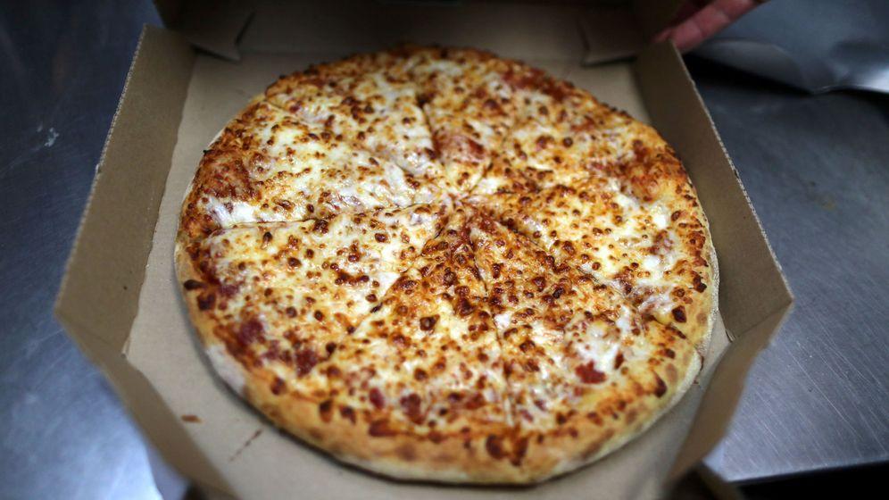 Foto: La pizza a domicilio es una de las cenas más recurrentes... y dañinas (Reuters/Lucy Nicholson)
