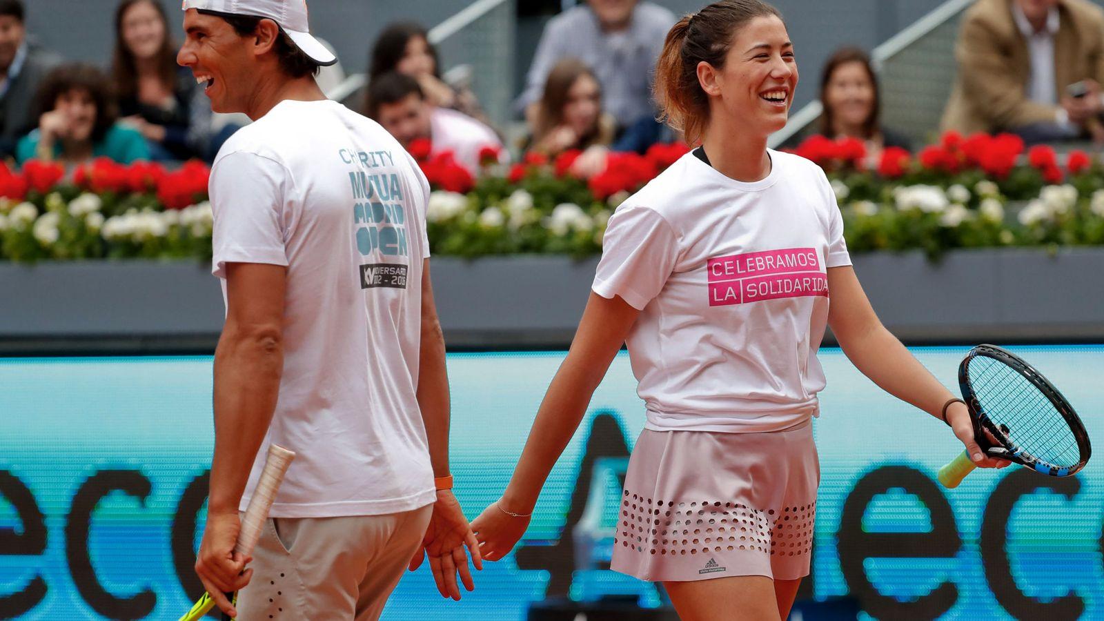 Foto: Rafa Nadal y Garbiñe Muguruza, durante la última edición del Mutua Madrid Open. (EFE)