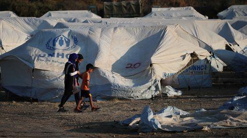 Los primeros 300 migrantes desalojados de Moria llegan al nuevo campamento