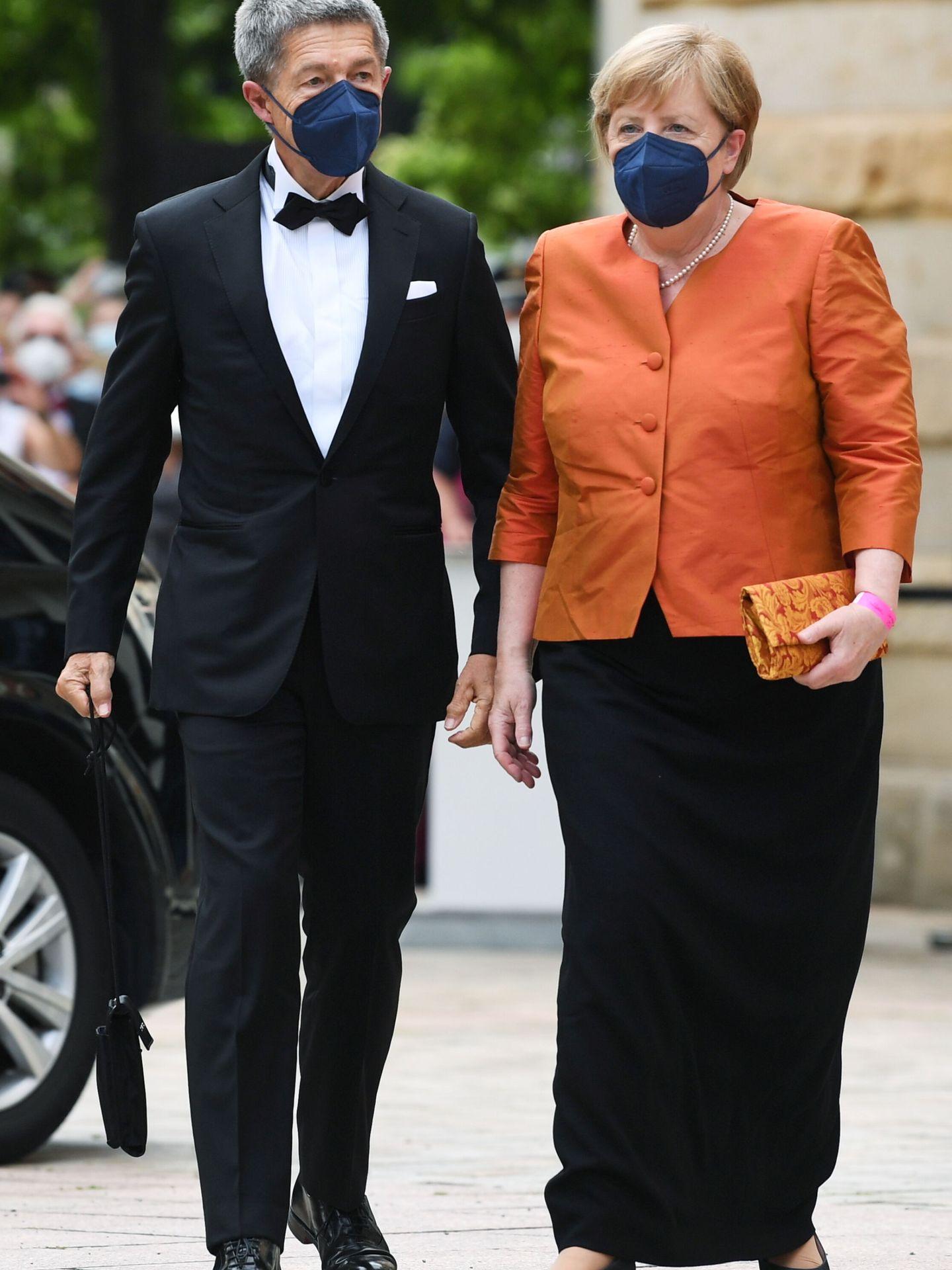 Angela Merkel y Joachim Sauer, en el festival de ópera Wagner en Bayreuth. (Reuters)