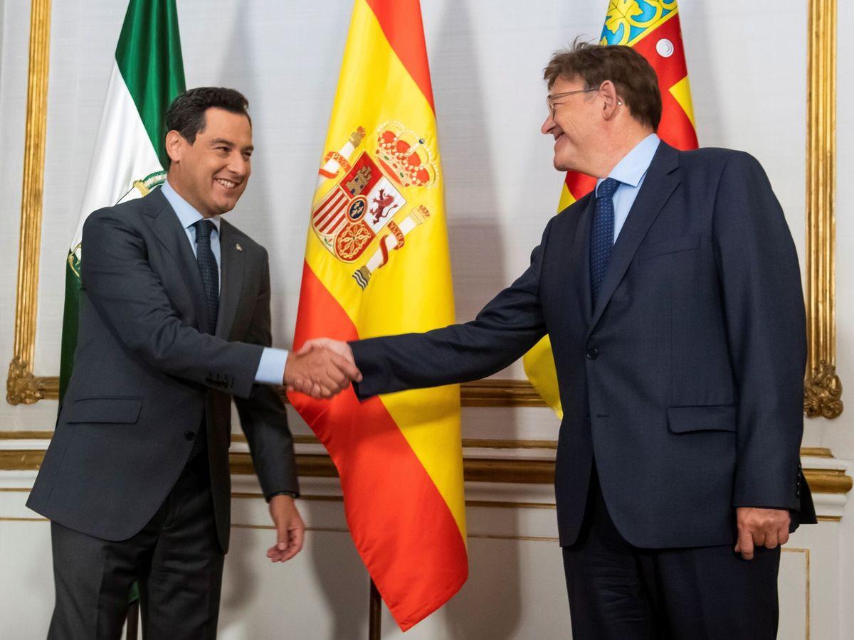 Foto: Juanma Moreno y Ximo Puig se reúnen en Sevilla. (EFE)
